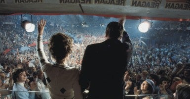 U.S. Presidential candidate, Ronald Reagan, and Nancy Reagan wave to the crowds from the podium at the 1976 Republican convention held in Kansas City, where the presidential nomination went to President Gerald Ford by a narrow margin. (Photo: Michael A. W. Evans/ZUMA Press/Newscom)