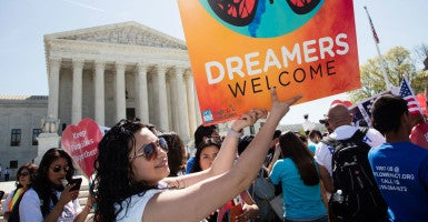 Demonstrators gather outside the U.S. Supreme Court during oral arguments challenging President Obama's immigration actions. (Photo: Jeff Malet/Newscom)