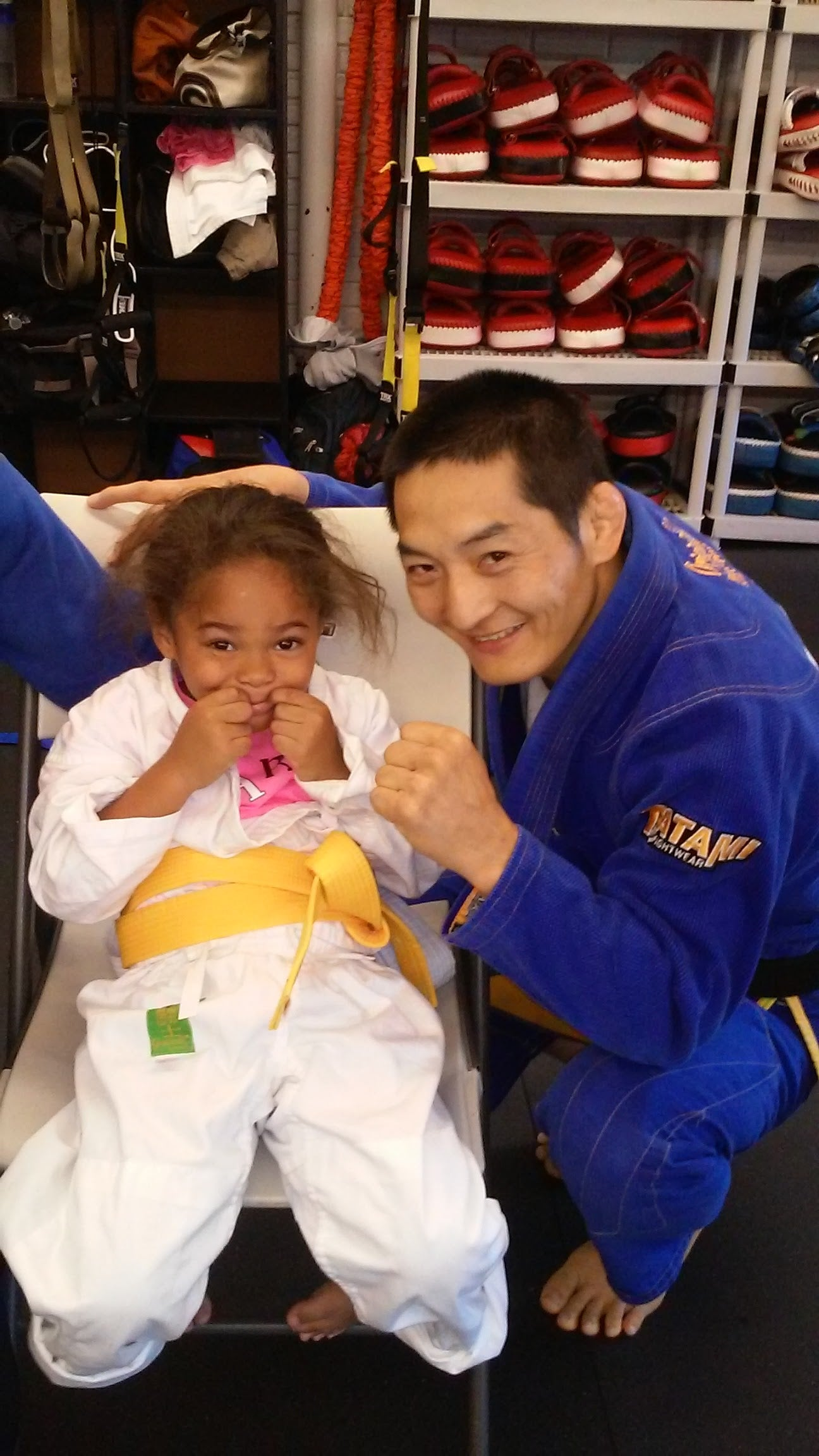 Sarah Padilla and her mixed martial arts teacher, or sensei. Through Our Military Kids, Padilla received a grant that paid for her mixed martial arts classes. (Photo: Ray Payton)