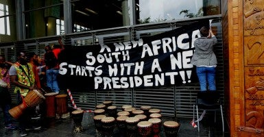 A gathering at the South African Constitutional Court calling for President Jacob Zuma to resign. (Photo: Jim  Ludbrook/EPA/Newscom)