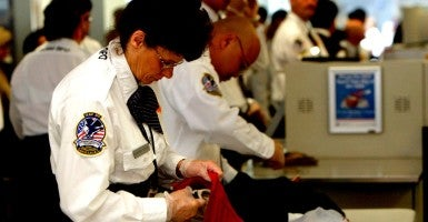 A Transportation Security Administration (TSA) screener inspects a bag at the international terminal of San Francisco International Airport. (Photo: istockphoto)