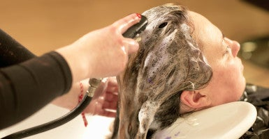 In Tennessee, anyone wanting to shampoo hair at a salon in the state must attain a license, logging 300 hours of education and taking a course costing more than $3,000 to do so. The Beacon Center of Tennessee and Memphis, Tenn., native Tammy Nutall-Pritchard are challenging those state regulations. (Photo: Peter Muller Cultura/Newscom)