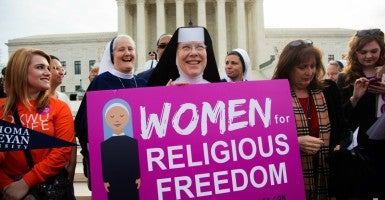 Catholic nuns outside the United States Supreme Court building during oral arguments for Zubik v. Burwell. (Photo: Jeff Malet Photography/Newscom)