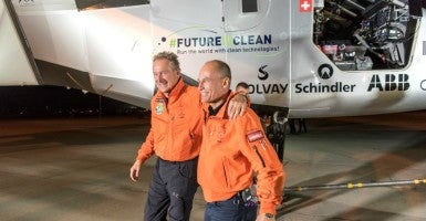 Pilots André Borschberg and Bertrand Piccard  after landing Solar Impulse 2 in Phoenix, Ariz., on May 2. (Photo: Handout/Reuters/Newscom)