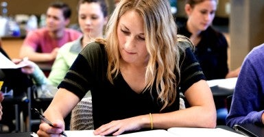 Fairer grading will help young women and men identify their own talents and abilities and make the most of their college years.  (Photo: Hill Street Studios Blend Images/Newscom)