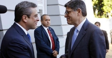US Treasury Secretary Jacob Lew shakes hands with Puerto Rico governor Alejandro Garcia Padilla before a meeting at La Fortaleza government headquarters in San Juan, Puerto Rico on Jan. 20. (Photo: Thais Llorca/EFE/Newscom)