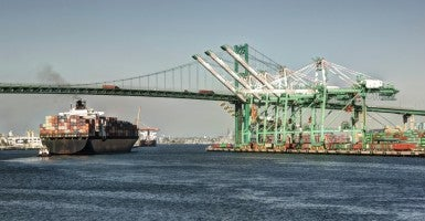 Container ship under the Vincent Thomas Bridge in San Pedro. (Photo: iStock Photo)