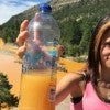 Rayna Willhite of Aztec, N.M., holds a bottle of water she collected from the Animas River on Aug. 6, 2015. (Photo: Jerry McBride/The Durango Herald / Polaris/Newscom)
