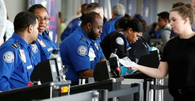 Transportation Security Administration agents check-in passengers at John F. Kennedy Airport in the Queens borough of New York City, May 27, 2016. (Photo: Brendan McDermid /Reuters/Newscom)
