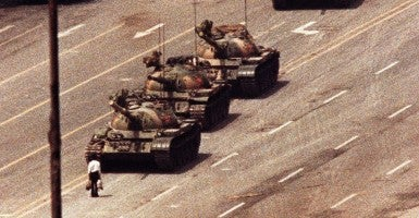 A man stands in front of a convoy of tanks in the Avenue of Eternal Peace in Tiananmen Square in Beijing in this June 5, 1989. (Photo: Stringer/Reuters/Newscom)