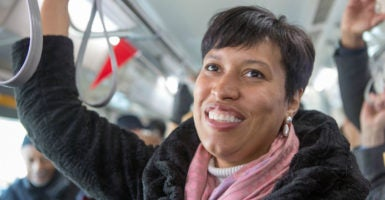 D.C. Mayor Muriel E. Bowser on Monday signed the city's minimum wage bill into law . (Photo: Cheriss May/Zuma Press/Newscom)