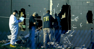 Forensic investigators at the crime scene in Orlando. (Photo: Jim Young/Reuters/Newscom)