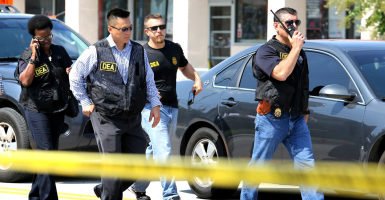 DEA agents arrive on the scene near the Pulse nightclub as the investigation continues into the massacre that killed at least 50 people on June 13  in Orlando. (Joe Burbank/Orlando Sentinel/TNS)