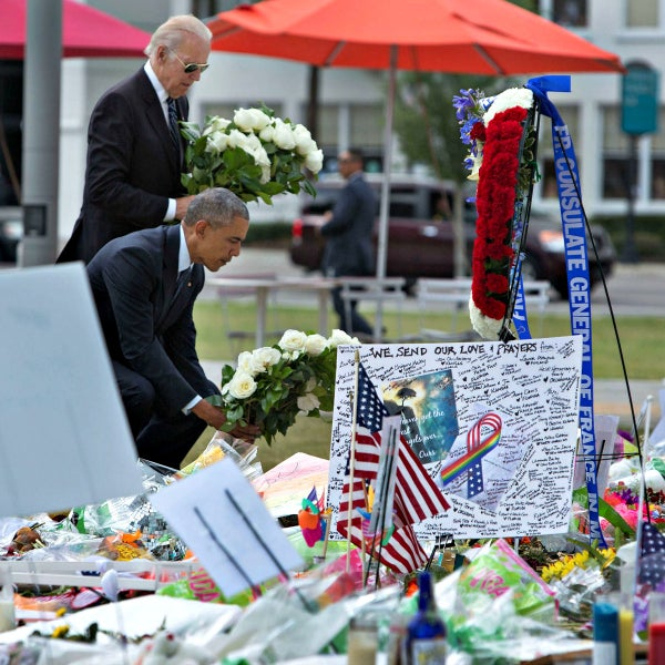 President Barack Obama and Vice President Joe Biden pay their respects June 16 at a makeshift memorial for the dead and wounded outside the Dr. Phillips Center for the Performing Arts. (Photo: David Lienemann/Zuma Press/Newscom)