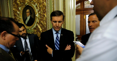 U.S. Sen. Chris Murphy, D-Conn., speaks to reporters after ending a 14-hour filibuster. (Photo: Jonathan Ernst/ Reuters/Newscom)