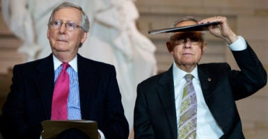 Senate Majority Leader Mitch McConnell, shown with Minority Leader Harry Reid, has promised another vote on a gun control measure Thursday. (Photo: Tom Williams/CQ Roll Call/Newscom)