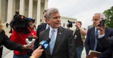 Former Virginia Gov. Bob McDonnell leaving the Supreme Court. (Photo: Jim lo Scalzo /EPA/Newscom)