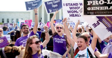 Outside the Supreme Court after the court's ruling in Whole Woman's Health v. Hellerstedt on June 27. (Photo: Michael Reynolds/Newscom)