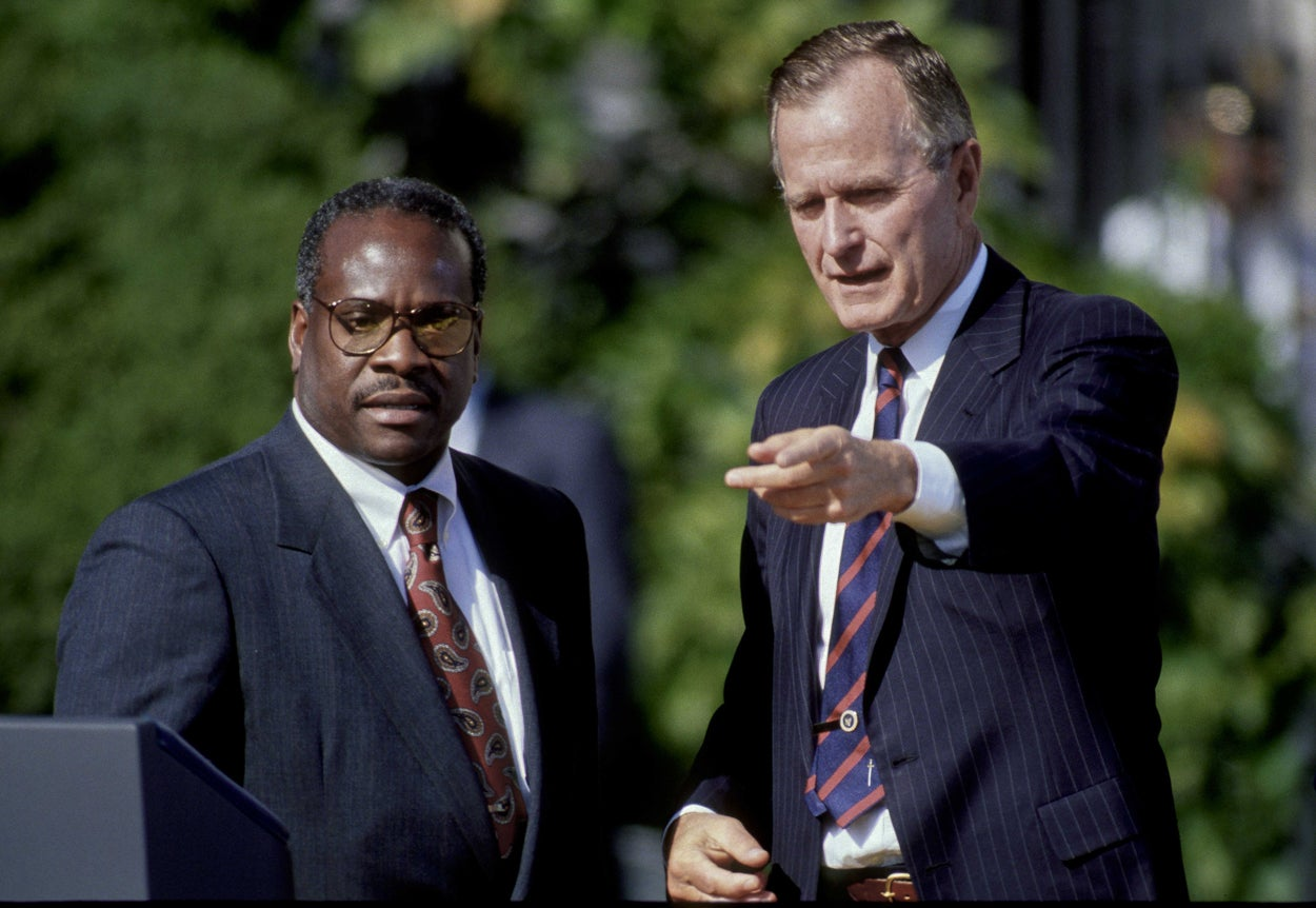 President George H.W. Bush with Clarence Thomas after he was sworn in as a Supreme Court justice. (Photo: Mark Reinstein/ZUMA Press/Newscom)