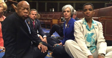 Democrats staged a sit-in on the House floor, June 22, demanding a vote on gun control. (Photo: Donna Edwards/ZUMA Press/Newscom)