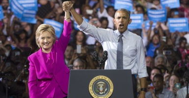 President Barack Obama and former Secretary of State Hillary Clinton hold hands after an event in Charlotte, North Carolina, on Tuesday, hours after the FBI announced it wouldn't seek charges against Clinton. (Photo: Kevin Dietsch/UPI/Newscom)