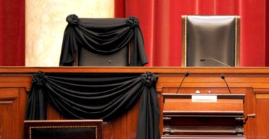 The bench of late Supreme Court Justice Antonin Scalia is seen draped with black wool crepe in memoriam inside the Supreme Court in Washington, on Feb. 16. (Photo: Carlos Barria/ Reuters/Newscom)