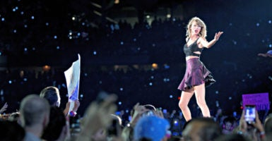 "Taylor Swift performs July 19, 2015, at Soldier Field in Chicago during her ""1989"" world tour. (Photo: Daniel DeSlover/Zuma Press/Newscom)"