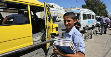 This young man is among Palestinian students returning to U.N.-run schools in the Gaza Strip on Aug. 31, 2015. (Photo: Mohammed Asad/APA Images/Polaris/Newscom)