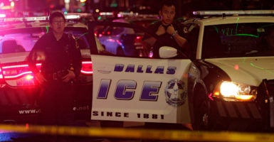 Dallas police officers gather in downtown after 11 police officers were shot. (Photo: Ralph Lauer/EPA/Newscom)
