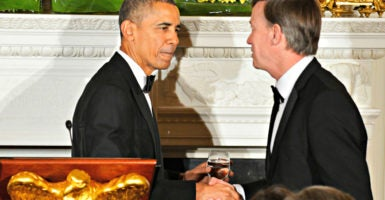 Colorado Gov. John Hickenlooper, here with President Barack Obama following a toast at the White House on Feb. 22, 2015, sued the Obama administration over a bird called the Gunnison sage grouse days before this photo was taken. (Photo: Mike Theiler/Reuters/Newscom)