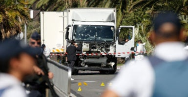 French police secure the area as the investigation continues at the scene near the heavy truck that ran into a crowd at high speed killing 84 people who were celebrating the Bastille Day national holiday in Nice, France. (Photo: Eric Gaillard /Reuters/Newscom)