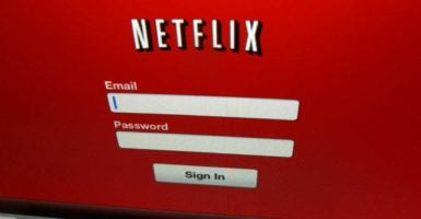 Sharing passwords from streaming services like Netflix could be illegal under a broad federal criminal statute. (Photo: Mike Blake /Reuters/Newscom)