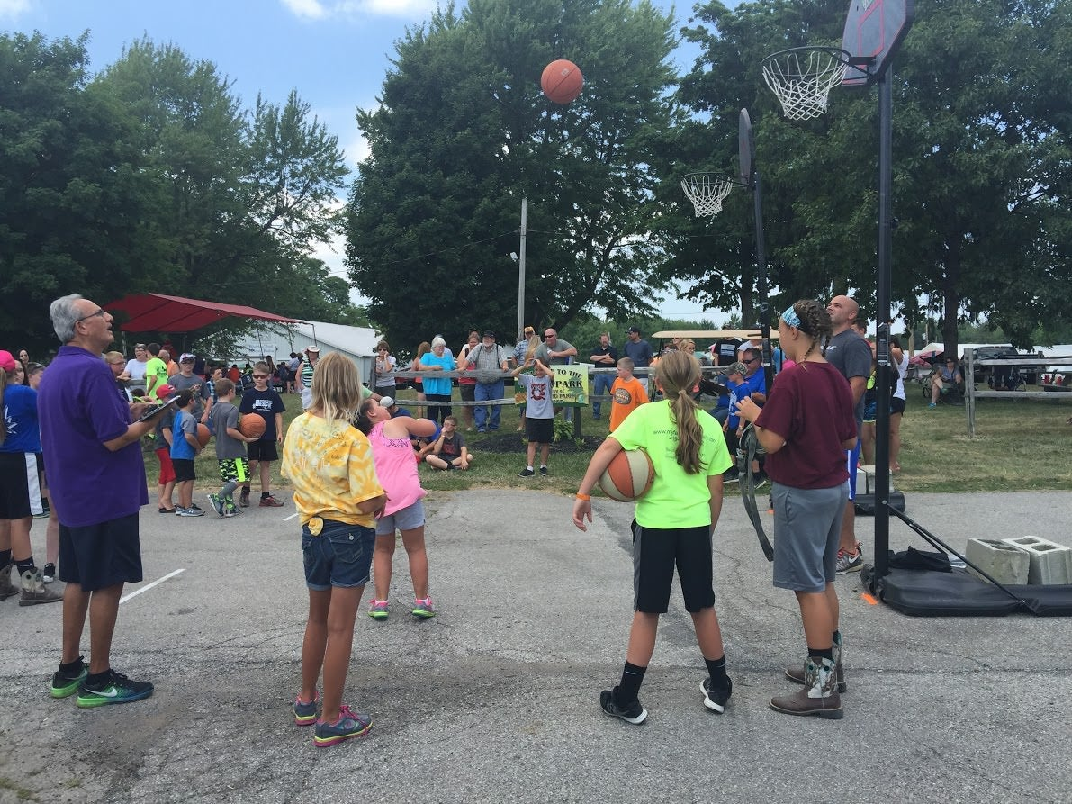 At the Crawford County Fair in Bucyrus, Ohio, attendees participate in a free-throw competition. (Photo: Rob Bluey/The Daily Signal)