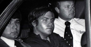 John Hinckley Jr. is flanked by federal agents as he is driven away from court on April 10, 1981. Hinckley was convicted in a 1982 trial that included evidence he shot President Ronald Reagan in an effort to impress Jodie Foster, an actress he had never met. (Photo: UPI/Newscom)
