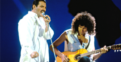 The late Freddie Mercury, left, and Brian May of Queen perform at the Live Aid charity concert at Wembley Stadium in London on July 13, 1985. (Photo: David Plastic/Retna UK/Newscom)