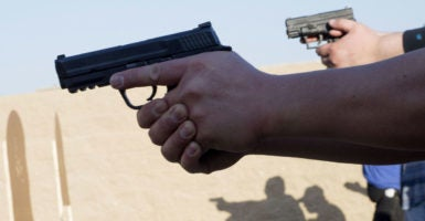 Students training for a license to carry a concealed weapon practice shooting drills in Chino, Calif. (Photo: Jebb Harris/ZUMA Press/Newscom)