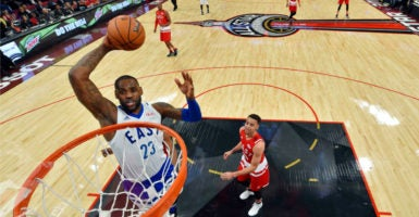 LeBron James of the Cleveland Cavaliers goes up for a dunk during the NBA All-Star Game last year. This year, the NBA has moved the All-Star game from North Carolina, citing the HB2 law. (Photo: USA Today Sports/Newscom)