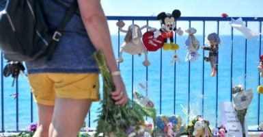 "A visitor stops at a memorial on the Promenade des Anglais in tribute to the 84 who died the terrorist attack in Nice, France. The attack was ""the fault of a state, failing in its first priority, which is the protection of our citizens,"" the leader of France's far-right National Front party says. (Photo: Norbert Scanella /Panoramic/Starf/Starface /Polaris/Newscom)"