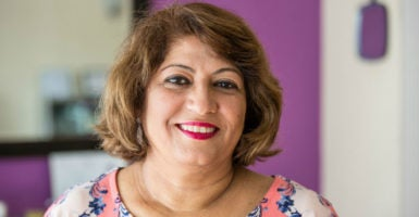 Lata Jagtiani, owner of Threading Studio & Spa in Metairie, Louisiana, struggles to keep her threading salon afloat with occupational licensing laws. (Photo: Courtesy of the Institute for Justice)