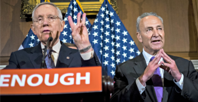 Senate Minority Leader Harry Reid, left, and Sen. Chuck Schumer, D-N.Y., pictured here on June 20, 2016, are among liberals demanding names of donors to conservative and liberal think tanks. (Photo: Pete Marovich/UPI/Newscom)