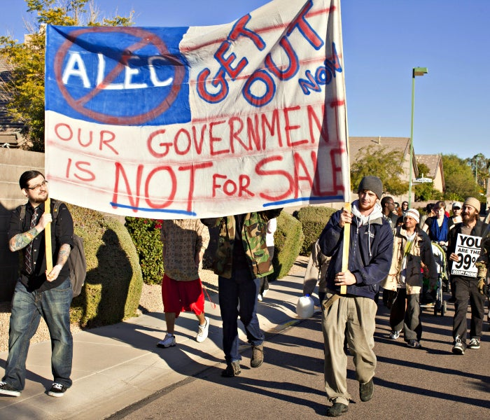 - Phoenix, AZ, America - Anti-ALEC Protesters march through a residential neighborhood in Phoenix on Nov. 30, 2011, on their way to picket the American Legislative Exchange Council during ALEC's meeting at the Westin Kierland Resort and Spa. (Photo: by Jack Kurtz/ ZumaPress/Newscom)
