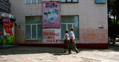 Spray-painted signs pointing to the nearest bomb shelter, like this one in Mariupol, are common sights in cities across Ukraine. (Photo: Nolan Peterson/The Daily Signal)