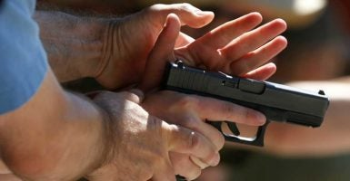 Talking with someone who disagrees about gun rights can be tricky. (Photo: Jim Urquhart /Reuters/Newscom)