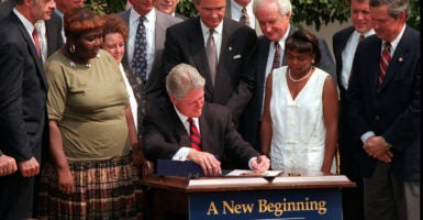 President Bill Clinton signs the Personal Responsibility and Work Opportunity Reconciliation Act at the White House, Aug. 22, 1996. (Photo: Chuck Kennedy/KRT/Newscom)