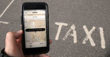 Taxes and protectionist schemes will not save the taxi industry from innovations like Uber and Lyft. (Photo:  Niall Carson/Zuma Press/Newscom)