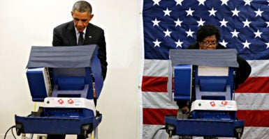 President Barack Obama votes early at a polling station in Chicago, Illinois, on Oct. 20, 2014. Illinois is one of two states where hackers recently targeted voter data. (Photo: Kevin Lamarque/Reuters/Newscom)
