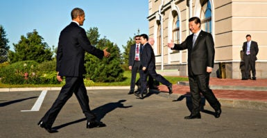 Chinese President Xi  Jinping  greets President Barack Obama during the 2013 G-20 summit in St. Petersburg, Russia. This year's G-20 meeting is being held in China this weekend. (Photo: Pete Souza/Zuma Press/Newsom)