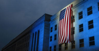 A memorial flag is illuminated, Sept. 11, 2007, near the spot where American Airlines Flight 77 crashed into the Pentagon on Sept. 11, 2001. (Photo: Brendan W. Schulze /MCT/Newscom)