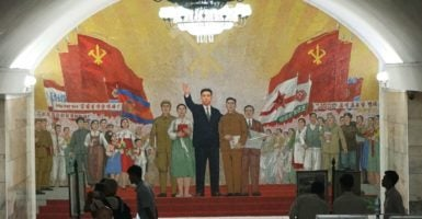 A view of a subway station in Pyongyang, North Korea. The man in the center of the mural is former North Korean dictator Kim Il Sung. (Photo: Li Ji/FEATURECHINA/Newscom)