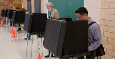 "Advocates of limited government are wary of  suggestions that the Obama administration is considering designating election systems, such as the one run here by Arlington County, as ""critical infrastructure"" subject to federal protection. (Photo: Rob Crandall/Stock Connection Worldwide/Newscom)"